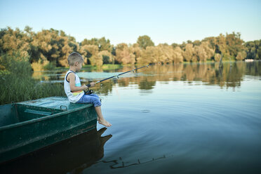 Little boy with fishing rod sitting on boat - ZEDF01493