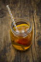 Glass of peach orange ice tea on wood - LVF07305