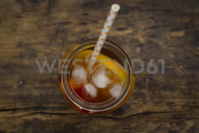 Glass of peach orange ice tea on wood - LVF07308