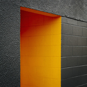 A doorway recess, painted orange in a grey block concrete wall. - MINF00343
