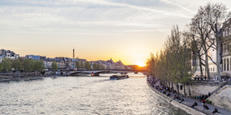 France, Paris, Pont du Carrousel with tourist boat at sunset - WDF04715