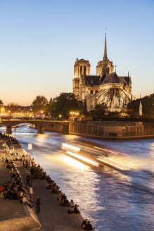 France, Paris, Tourist boat on Seine river with Notre Dame cathedral in background - WDF04718