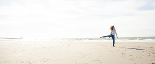 Netherlands, Zeeland, woman having fun on the beach - KNSF04201
