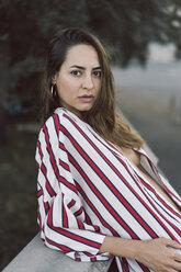 Portrait of woman wearing unbuttoned striped shirt - AFVF00860