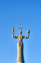 Germany, Constance, back view of Imperia statue against blue sky - JEDF00302