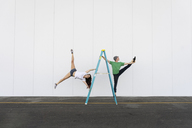 Two acrobats doing tricks on a ladder - AFVF00896