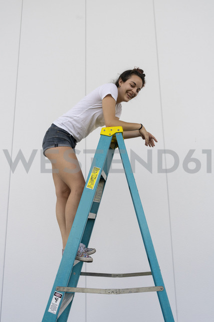 Acrobat standing laughing on a ladder - AFVF00902