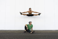 Two acrobats doing tricks together, jumping mid-air - AFVF00929