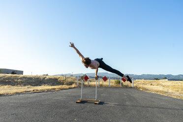Acrobat balancing on handstand canes - AFVF00953