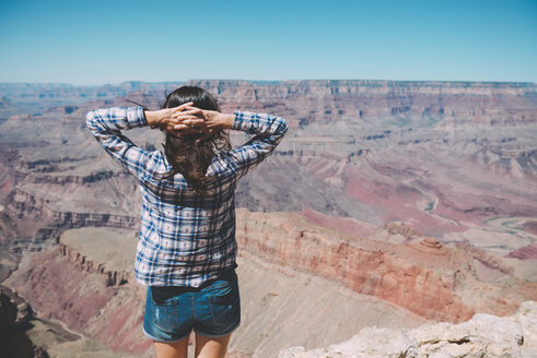 USA, Arizona, Grand Canyon National Park, Grand Canyon, back view of woman looking at view - GEMF02194