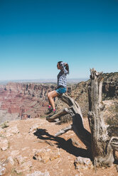 USA, Arizona, Grand Canyon National Park, Grand Canyon, woman looking at view - GEMF02206