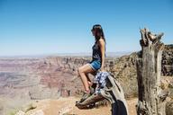 USA, Arizona, Grand Canyon National Park, Grand Canyon, woman looking at view - GEMF02209
