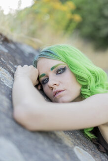 Portrait of young woman with dyed green hair and eyebrows in nature - AFVF01005