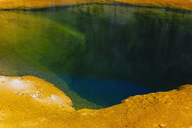 Detail of colourful water mineral deposits and rock formations from Midway Geyser, in Yellowstone National Park. - MINF01169