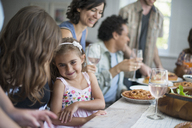 A family gathering for a meal. Adults and children around a table. - MINF01262