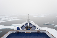 The view over the decks of a cruise ship in the Canadian Arctic region, moving through ice floes. - MINF01466