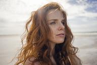 Portrait of a redheaded woman on the beach - KNSF04219
