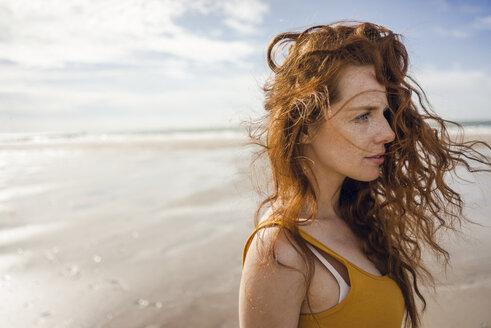 Portrait of a redheaded woman on the beach - KNSF04222