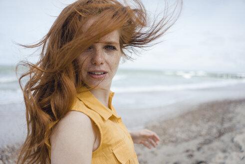 Portrait of a redheaded woman on the beach - KNSF04306