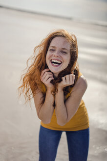 Redheaded woman, laughing happily on the beach - KNSF04309