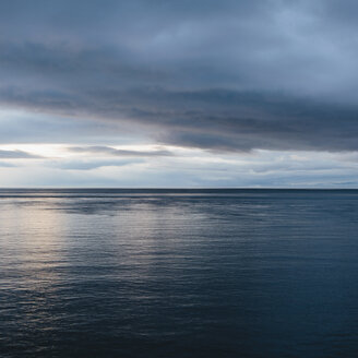 The sea and sky over Puget Sound in Washington, USA. The horizon with light cloud layers above. - MINF02119