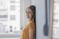 Happy woman leaning on wall - JOSF02293