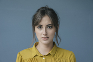 Portrait of a young woman wearing a yellow blouse - JOSF02353