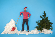 Man with Santa hat shoveling snow - BAEF01624