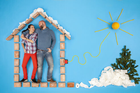 Couple standing in their home, powered by solar energiy - BAEF01642