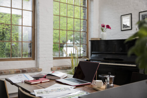 Home office with piano in background at comfortable loft apartment - FKF03037