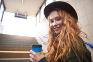 Portrait of smiling redheaded woman with coffee to go - ABIF00759