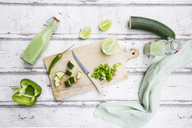 Glass bottles of homemade green Gazpacho and ingredients - LVF07330