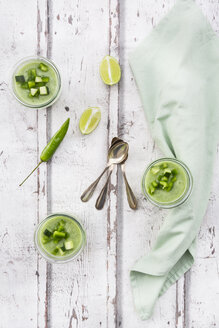 Three glasses of homemade green Gazpacho and ingredients - LVF07333