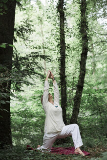 Senior woman doing yoga in the forest - ALBF00589