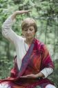 Senior woman doing yoga, meditating - ALBF00592