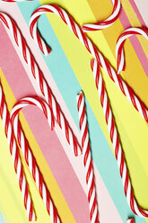 Candy canes on multi-coloured paper - AZF00047
