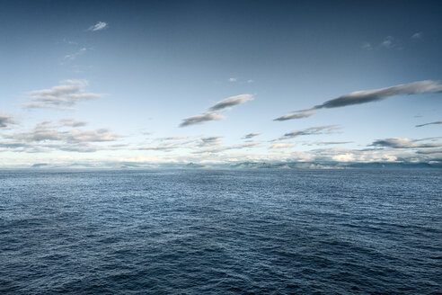 Iceland, Seyoisfjoerdur, coast, ocean and clouds - DMOF00044