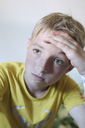 Portrait of pensive blond boy wearing yellow t-shirt - KMKF00433