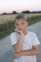 Portrait of blond boy at evening twilight - KMKF00439