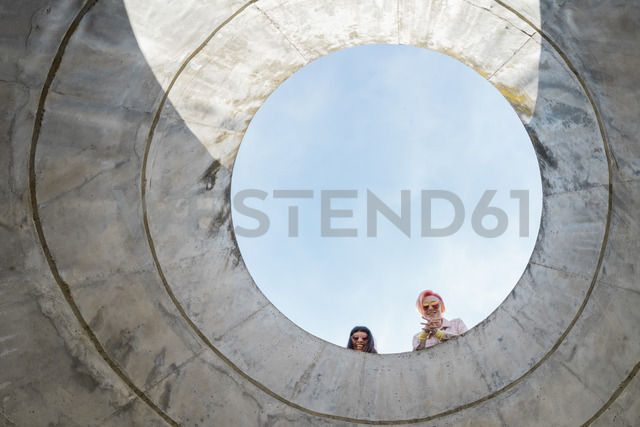 Two alternative friends looking through hole - AFVF01018