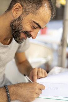 Man signing a book - AFVF01087
