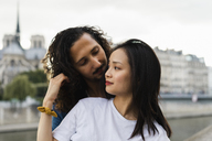 France, Paris, young couple in love at river Seine - AFVF01094