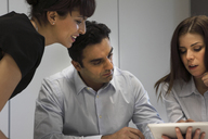 Business people using tablet computer - ISF17655