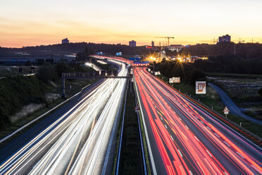 Germany, Baden-Wuerttemberg, Stuttgart, Autobahn A8 in the evening, light trails - WDF04770