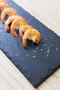 Row of shrimps on slate, salt - GIOF03997