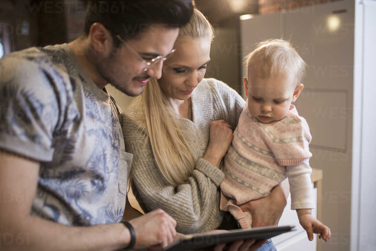 Young parents using tablet at home with their baby girl - AWF00130 - Inner Vision Pro/Westend61