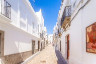 Spain, Andalucia, Tarifa, cobbled lane in old town - SMAF01075