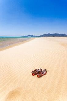 Spain, Andalucia, Tarifa, beach and sandals - SMAF01081