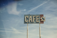 Neon cafe sign against blue sky - ISF17880