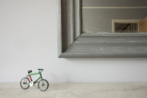 Miniature bicycle by mirror - ISF17993